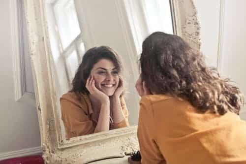 Girl looking towards mirror
